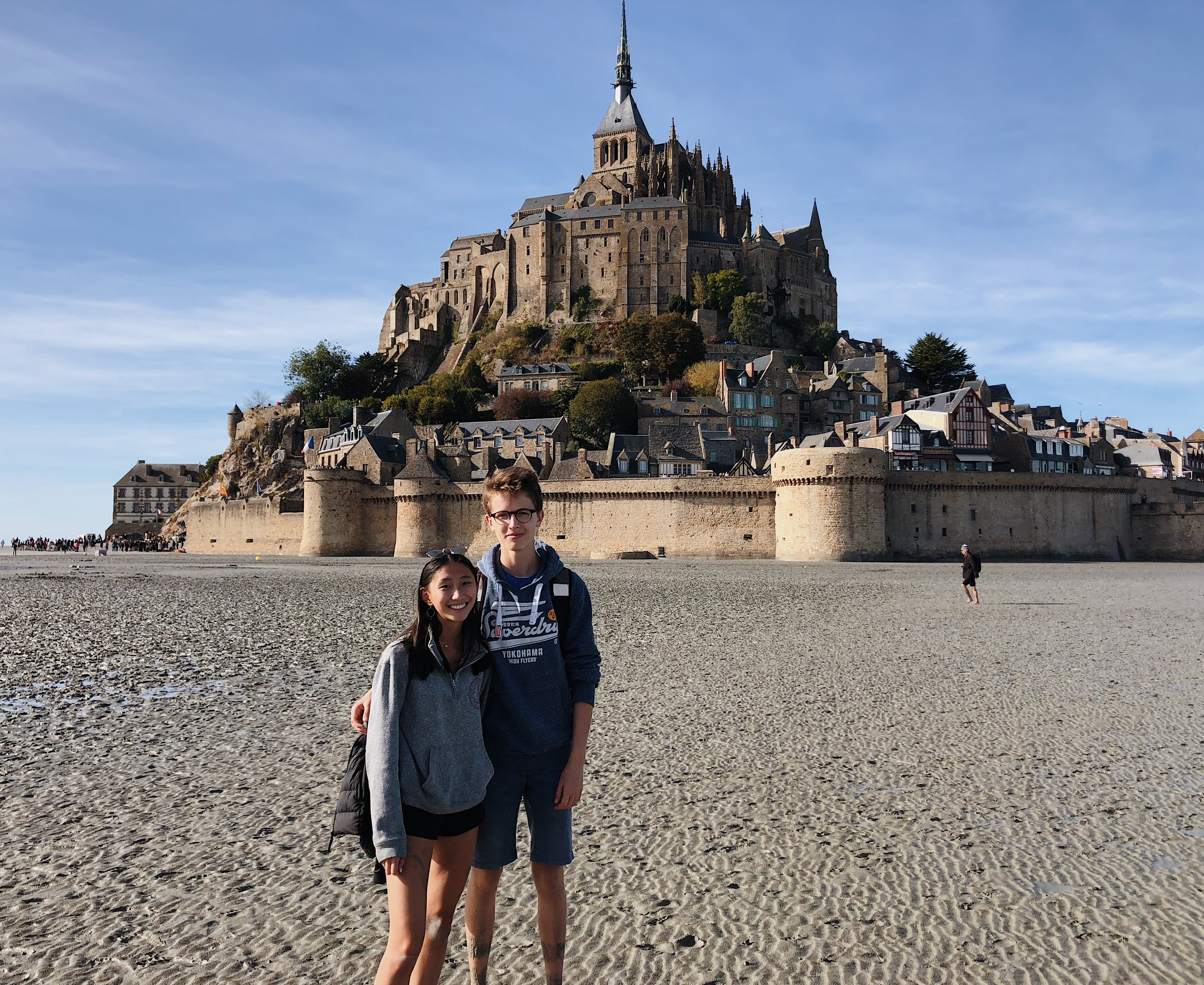 Maya with her host brother at Mont St. Michel.